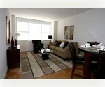 Spacious 2 Bedrooms, 2 Marble Bathrooms in Mid town West. Granite kitchen with White Appliances, Hardwood Floors.  24 hour Doorman Luxury Building.